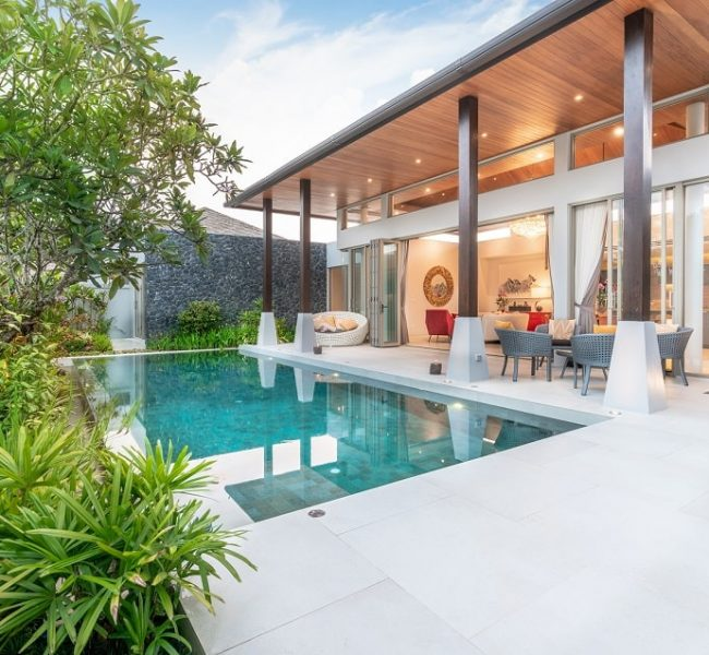 home-house-exterior-design-showing-tropical-pool-villa-with-greenery-garden-min
